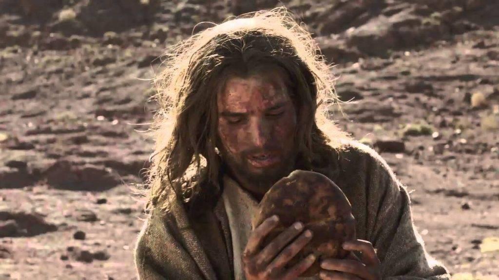 Tentação de Jesus. Jesus comendo pão no deserto.